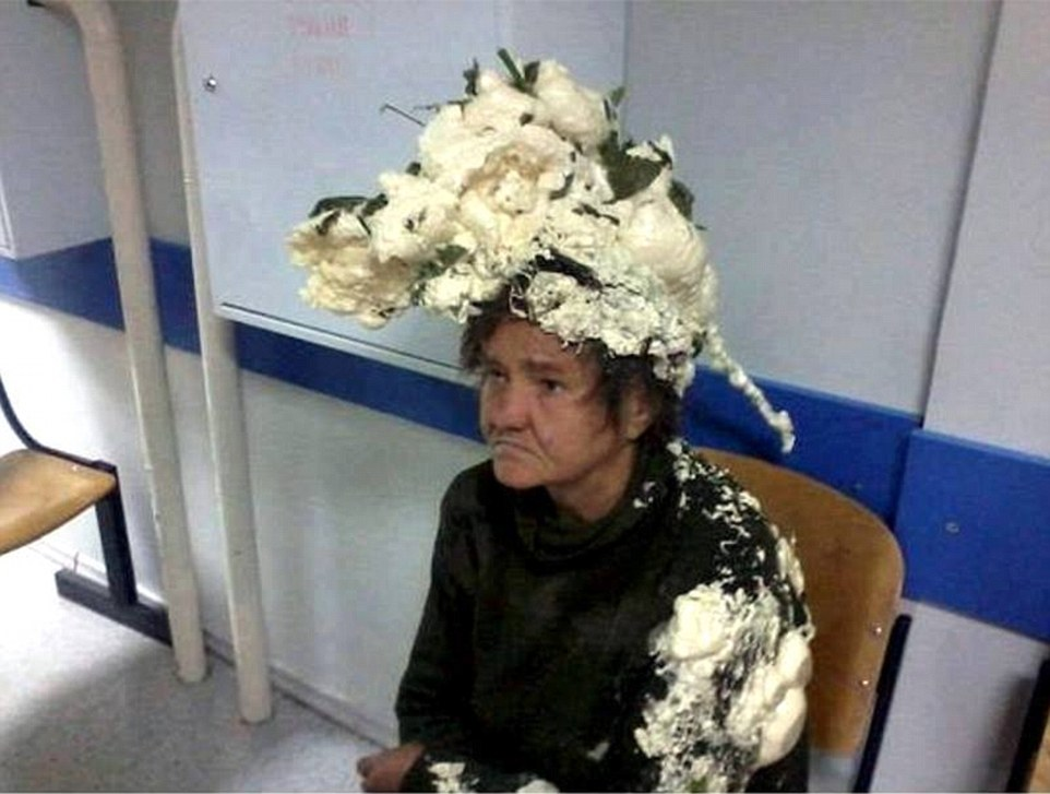 We don't really know what happened here. It was reported that a woman confused builders foam for hair mousse.